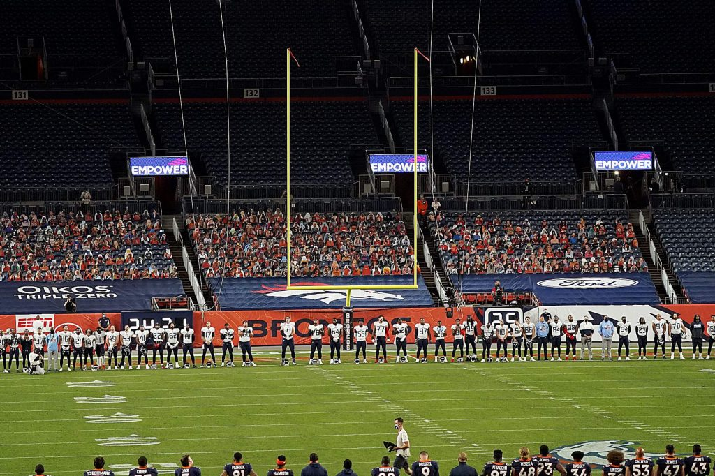 The Tennessee Titans stand during a rendition of