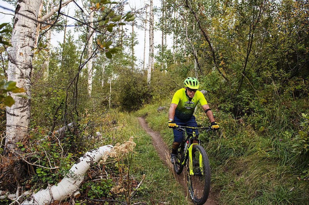 Mike Gettinger competes in the final Aspen Cycling Club race up Airline Trail in Sky Mountain Park on Wednesday, Sept. 16, 2020. There were 48 racers signed up to compete. The club organized the race to have 4 racers released every minute to help space out the competitors. (Kelsey Brunner/The Aspen Times)
