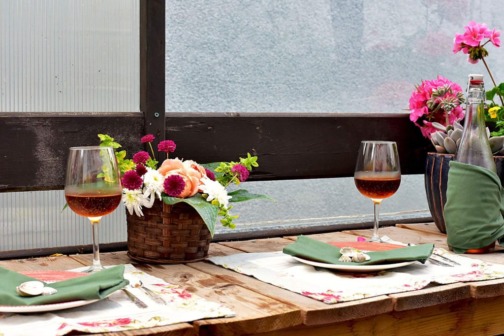 Fancy place setting for special events with beautiful flower arrangements and flower pots in outdoor restaurant