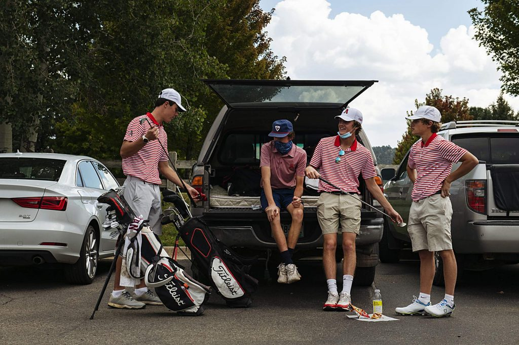 The Aspen High School boys golf team waits out a lightning delay in the parking lot of River Valley Ranch Golf Course during the regional tournament on Tuesday, Sept. 22, 2020, in Carbondale. Aspen's Nic Pevny was the individual champion, while the Skiers also won the team title. State is Oct. 5 and 6 in Gunnison.