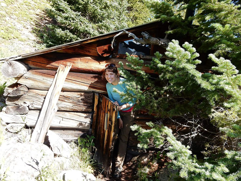 Hannah Condon checks out a miner's cabin on the Panama-Principle mining claims in the 2010s. The property was acquired Monday by conservation groups.