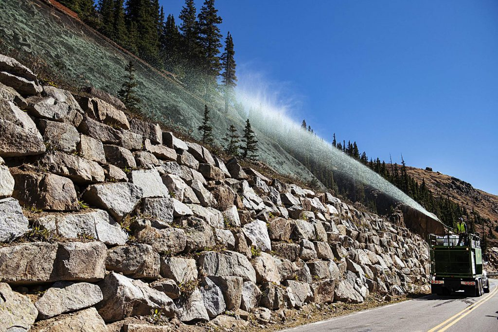 Todd Sutton sprays colored wood mulch on eroded areas on the side of Independence Pass on Wednesday, Sept. 30, 2020.