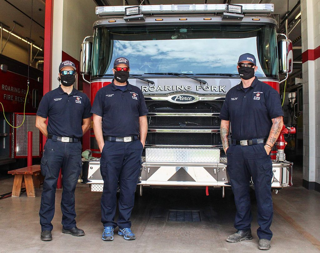 Will Shoesmith, Paul Blangsted and Duane Vasten of Roaring Fork Fire Rescue stand in front of an engine at the Basalt station on Aug. 26, 2020.