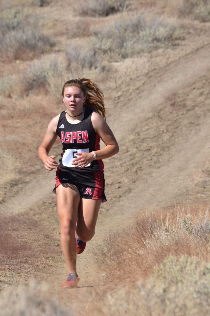 Aspen High School sophomore Stella Sherlcok competes at a cross country meet on Saturday, Sept. 5, 2020, in Hotchkiss.