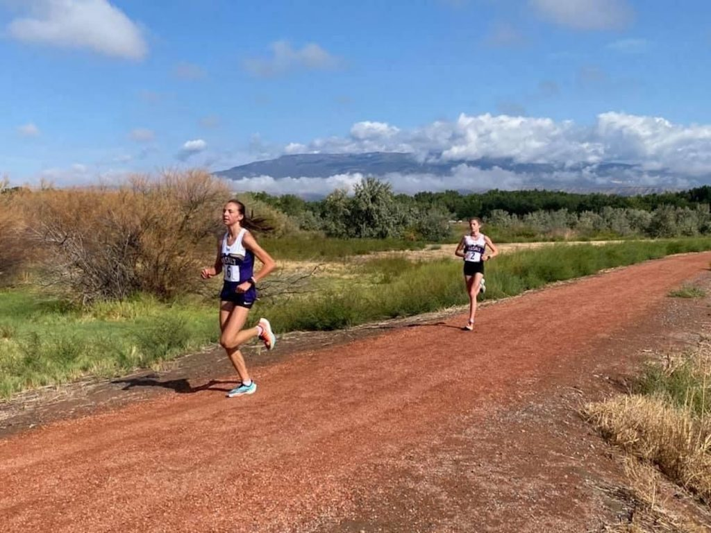 Basalt's Katelyn Maley, left, and Sierra Bower compete at a cross country meet in Delta on Friday, Sept. 11, 2020.