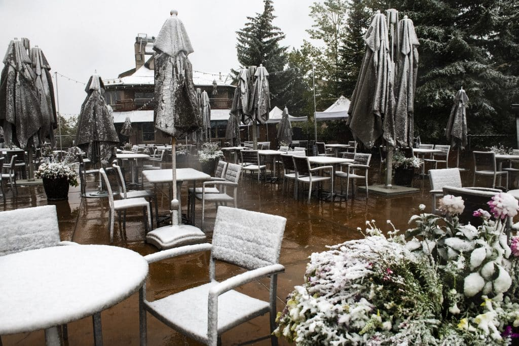 Snow settles on the outdoor seating at the Ajax Tavern in Aspen on Tuesday, Sept. 8, 2020.