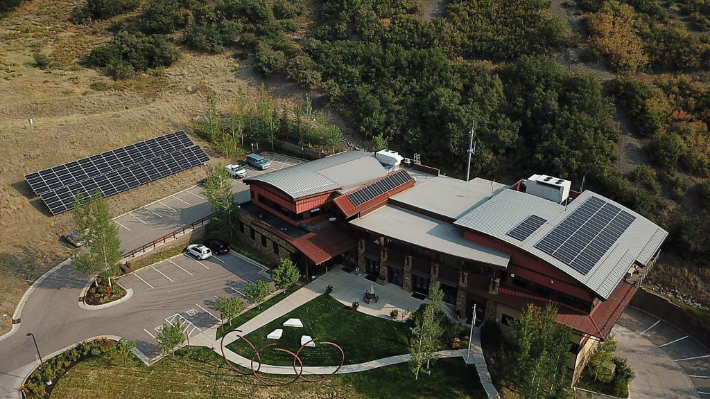 A drone image of the solar panels in place atop and adjacent to Snowmass Town Hall.