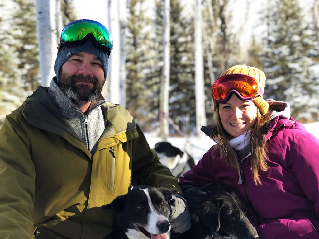 Sarah and Taylor Barnett pose for a photo while dogsledding with Krabloonik in early 2019.