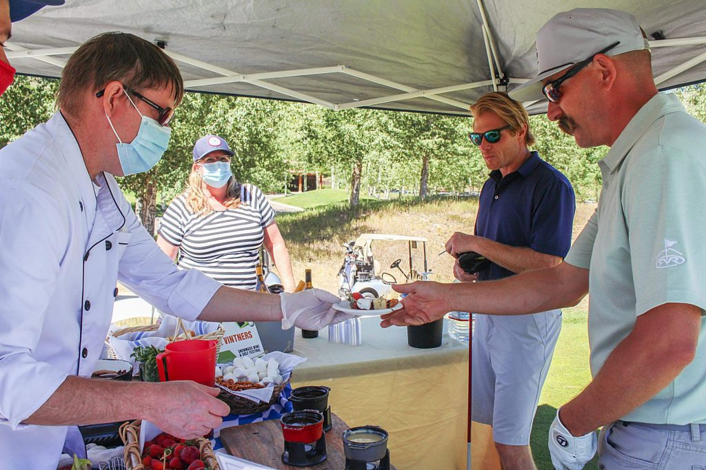 Golfers enjoy some fondue from The Edge on Sept. 3, 2020, during the Snowmass Wine and Golf Festival.