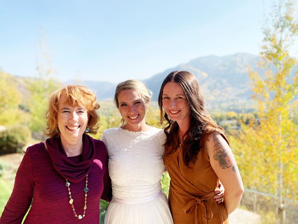 Bride Karen Morian with her mother and sister on her wedding day.