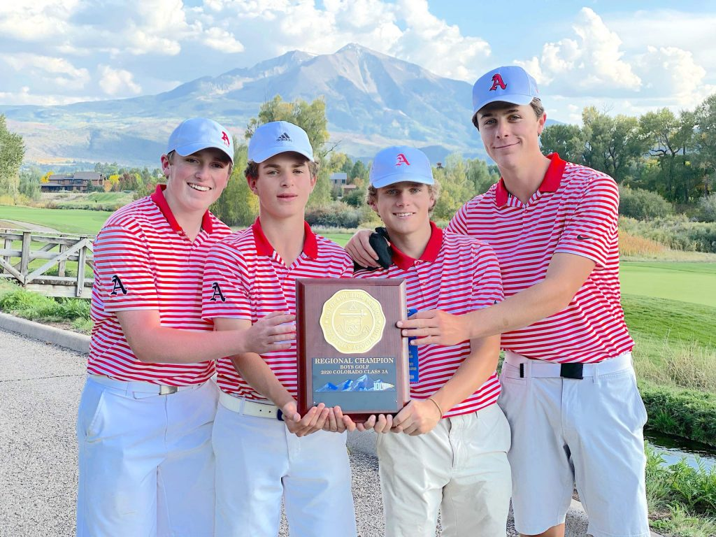 The Aspen High School boys golf team poses with its 2020 regional championship trophy last month at River Valley Ranch in Carbondale.