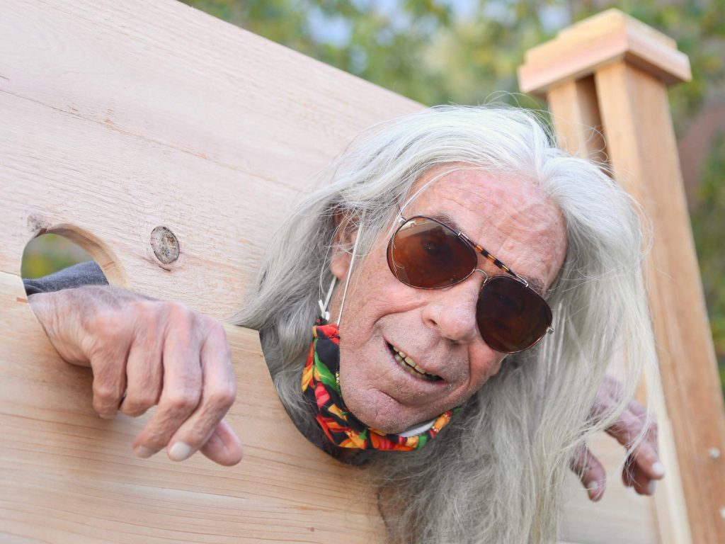 Former Pitkin County Sheriff Bob Braudis takes his turn in the stocks during the