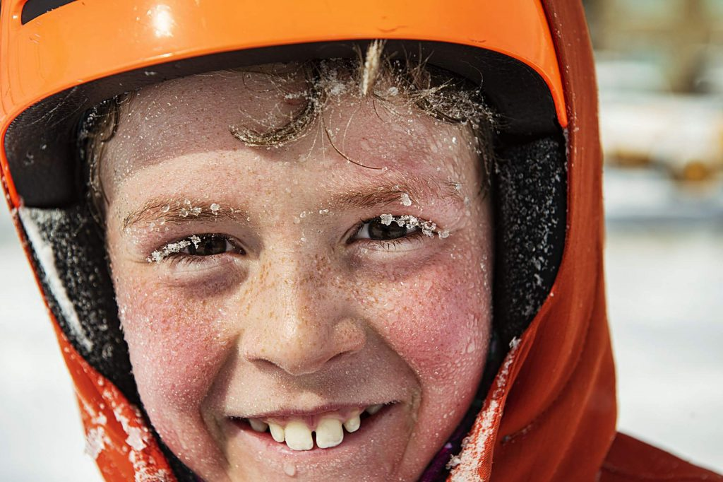 Jack Haynie, 11, grins after sledding down Little Nell on Aspen Mountain with his brother on Monday, Oct. 26, 2020.