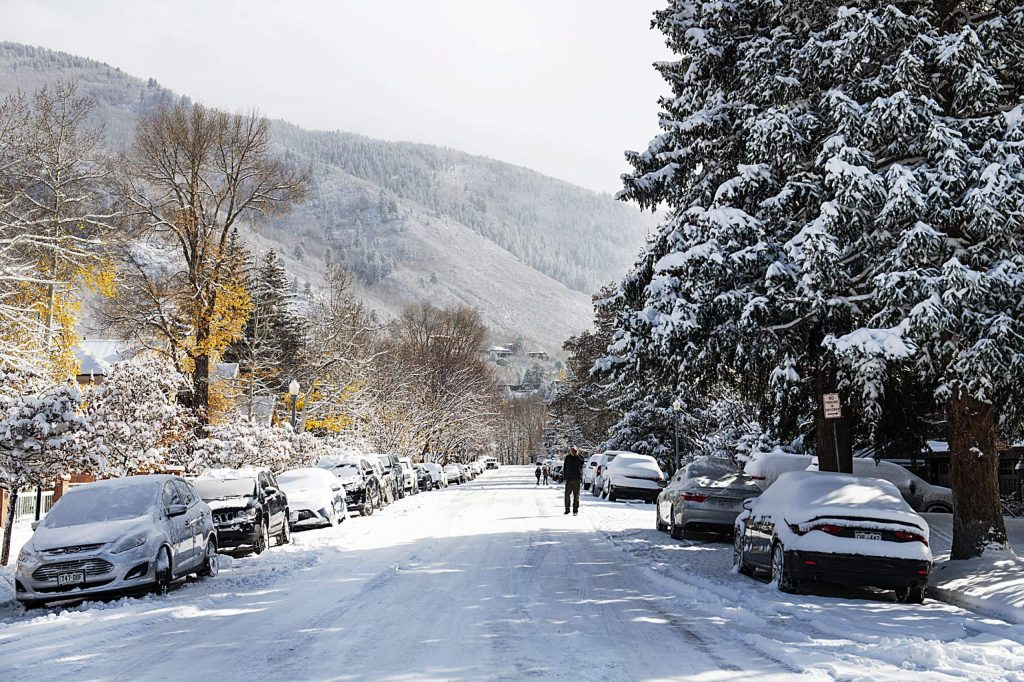 People walk through the street in downtown Aspen on Monday, Oct. 26, 2020.