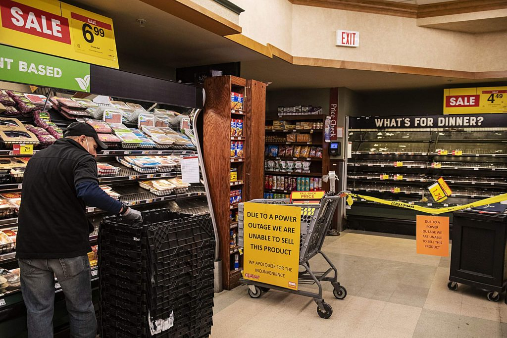 City Market grocers restock the refrigerated food after pulling their inventory due to a 3-hour power outage in Aspen on Monday, Oct. 26, 2020.