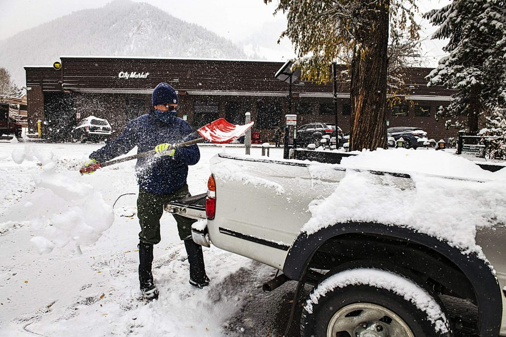 Sandy Schiff cleans off his A-1 Maintenance truck after a snowstorm in Aspen on Monday, Oct. 26, 2020.