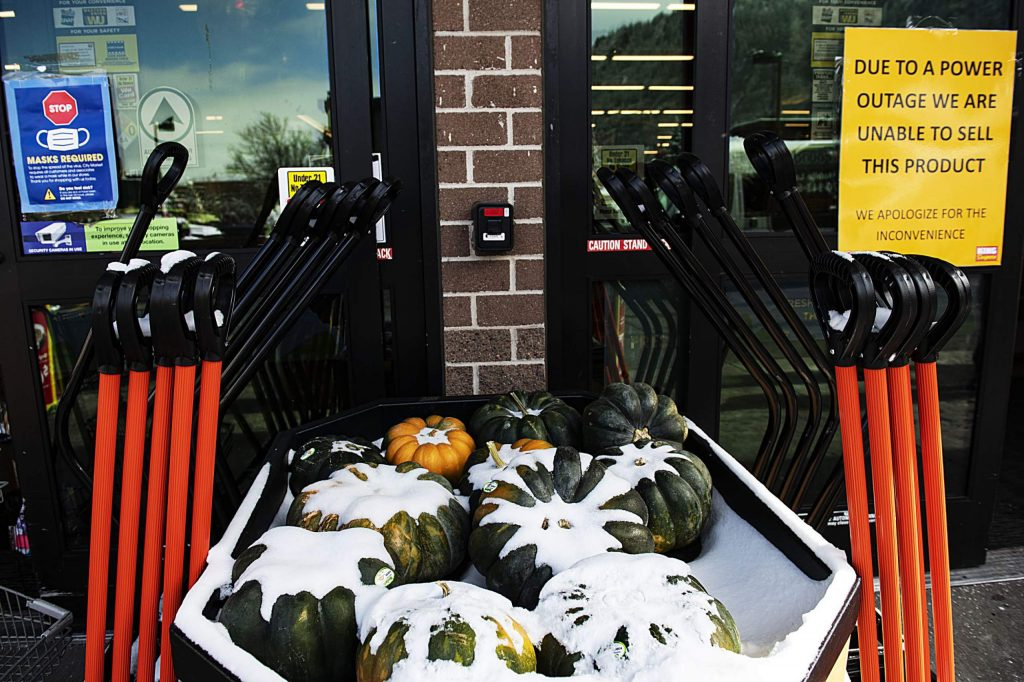 Pumpkin and snow shovels for sale outside of Aspen's City Market on Monday, Oct. 26, 2020.
