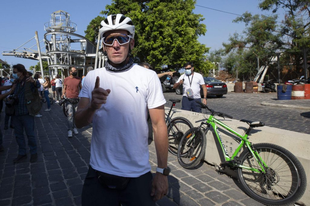 Former American professional cyclist Lance Armstrong, center, prepares to ride with Lebanese and foreign cyclists at the site of the Aug. 4 deadly blast in the port of Beirut that killed scores and wounded thousands in Beirut, Lebanon, Sunday, Oct. 4, 2020. Armstrong led a charity bike tour named