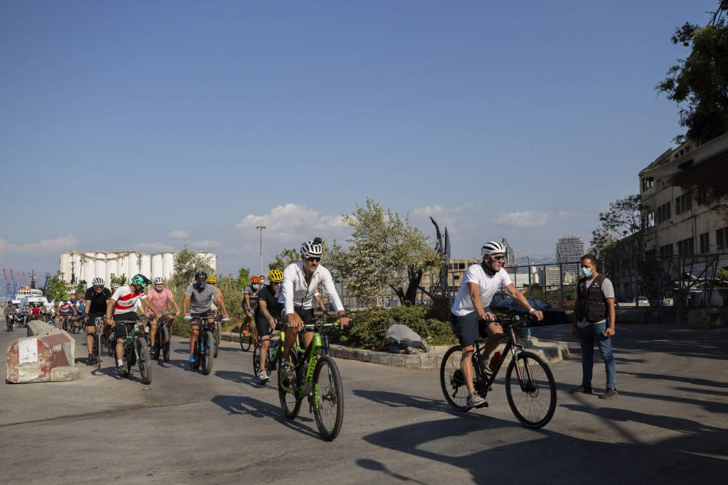 Former American professional cyclist Lance Armstrong, right, rides with Lebanese and foreign cyclists at the site of the Aug. 4 deadly blast in the port of Beirut that killed scores and wounded thousands in Beirut, Lebanon, Sunday, Oct. 4, 2020. Armstrong led the charity bike tour named