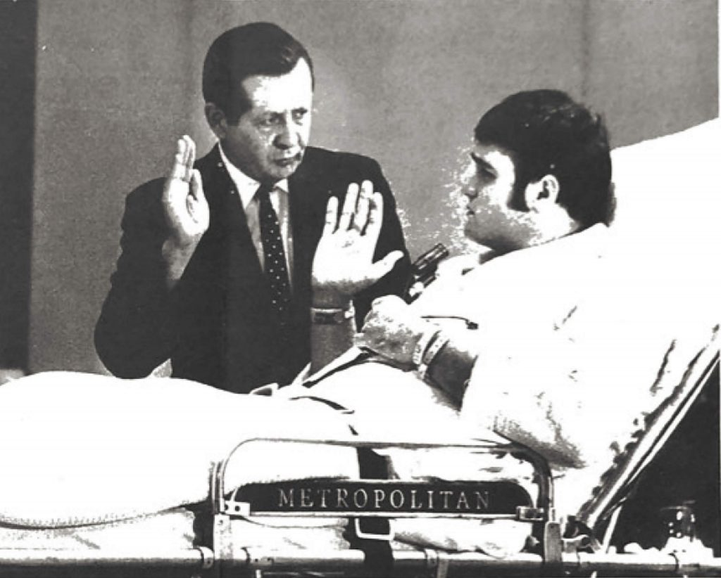 Rick Stephens is seen here in an old newspaper clipping getting ready to testify at a National Transportation Safety Board hearing after the crash while seated in a hospital bed.