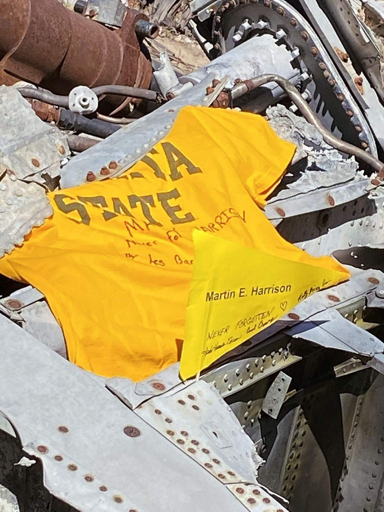 The Wichita State pennant placed at the crash site in honor of Martin Harrison by cousins Paul and Kelly Harrison.