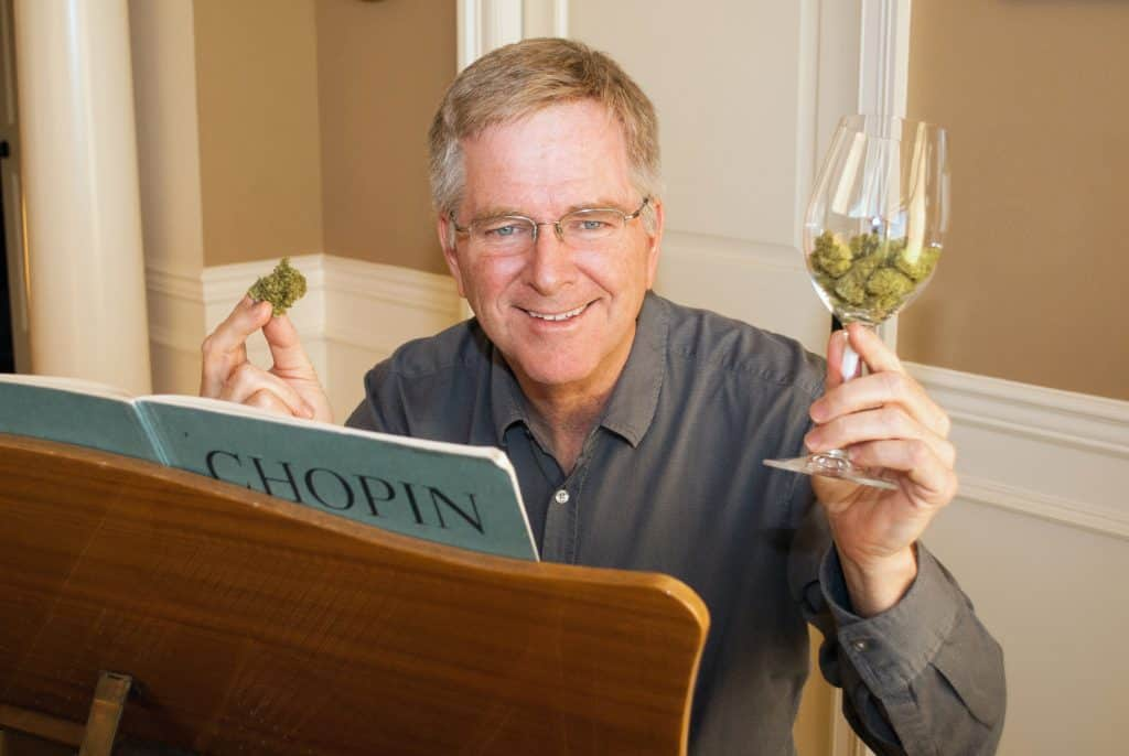 Rick Steves relaxing with two of his favorite pastimes at home in Edmonds, Washington, where his office window overlooks his old junior high school.