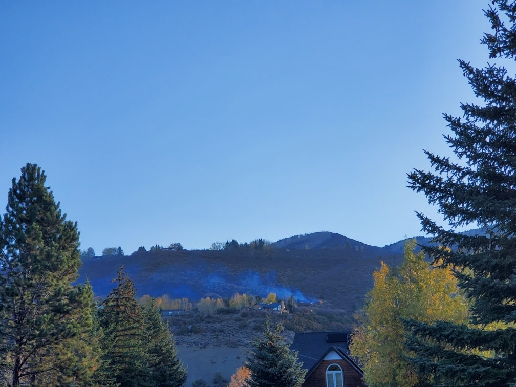 Flames and smoke can be seen early Wednesday morning on the hillside outside of Aspen and above the North 40 neighborhood, which is near the airport.