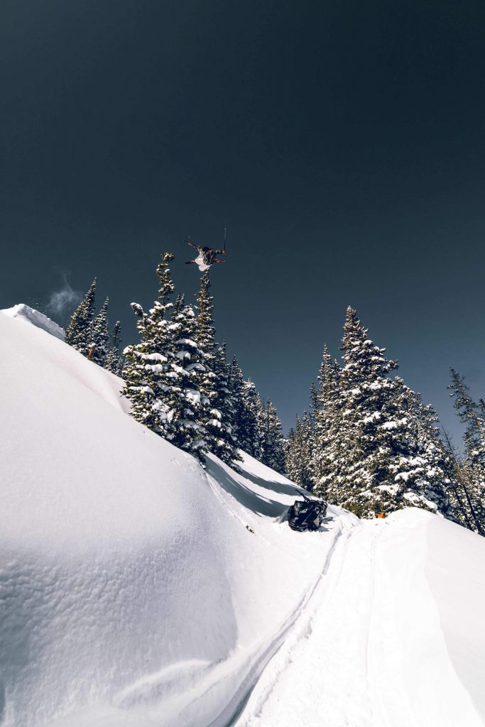 Tanner Hall hucks a trick off a backcountry jump in the local Colorado backcountry while filming for his new short film