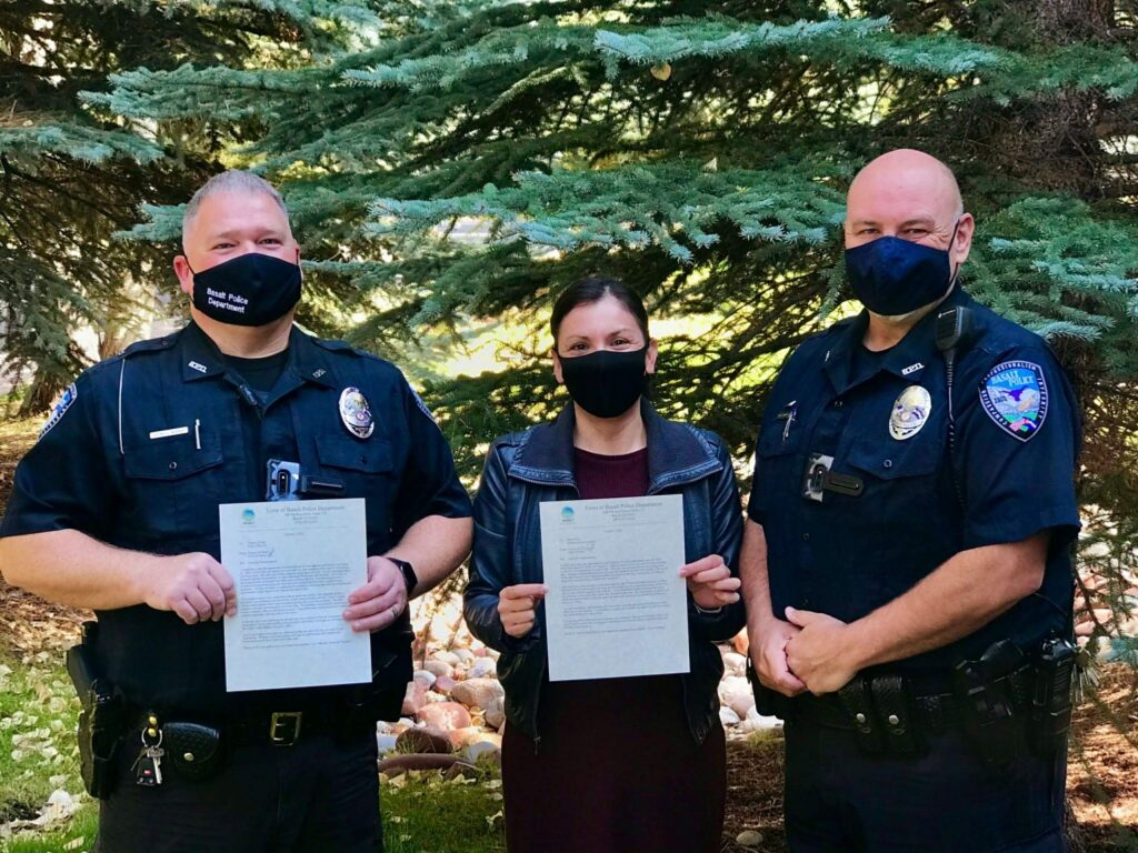 Basalt Police Chief Greg Knott (right) gave letters of commendation on Monday to Officer Thomas Wright and administrative assistant Dina Prieto.