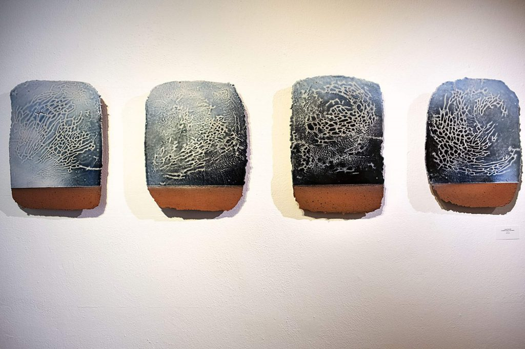 Ceramic pieces by Louise Deroualle hangs in the Red Brick gallery space on Wednesday, Sept. 30, 2020. (Kelsey Brunner/The Aspen Times)
