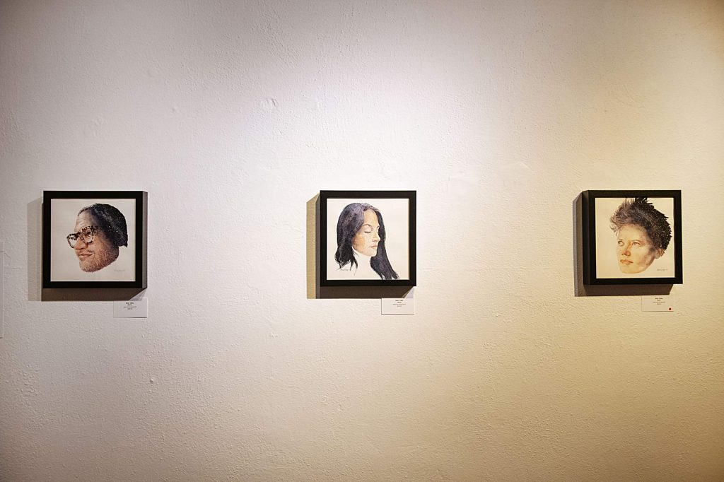 Brian Colley's watercolor portraits of friends hang in the Red Brick Center for the Arts on Wednesday, Sept. 30, 2020. (Kelsey Brunner/The Aspen Times)