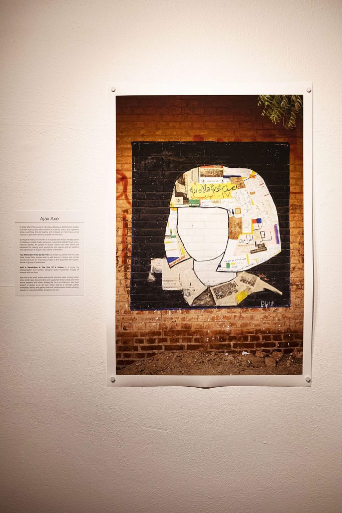 Work provided by Ajax Axe depicts a documentation of a mural created by a muralist in Sudan hangs in the Red Brick Center's new show on Wednesday, Sept. 30, 2020. (Kelsey Brunner/The Aspen Times)