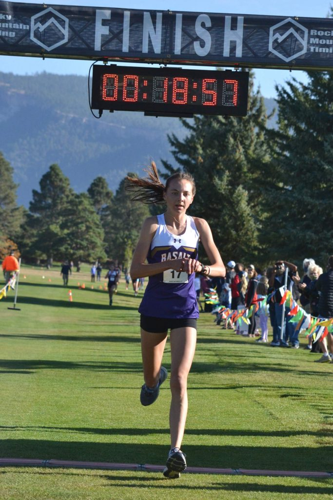 Basalt High School sophomore Katelyn Maley crosses the finish line to win the Class 3A, Region 1 race on Friday, Oct. 9, 2020, at Hillcrest Golf Club in Durango. (Joel Priest/Courtesy of the Durango Herald)