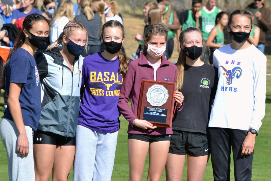 The Basalt High School girls cross country team celebrates after taking second in their Class 3A, Region 1 race on Friday, Oct. 9, 2020, at Hillcrest Golf Club in Durango. (Joel Priest/Courtesy of the Durango Herald)