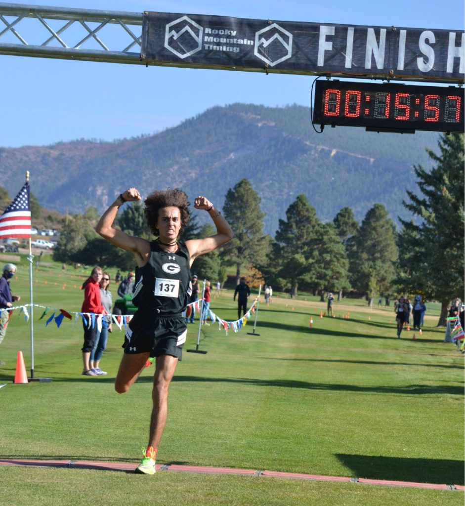 Gunnison's Alex Baca crosses the finish line to win the Class 3A, Region 1 boys' cross country race on Friday, Oct. 9, 2020, at Hillcrest Golf Club in Durango. (Joel Priest/Courtesy of the Durango Herald)
