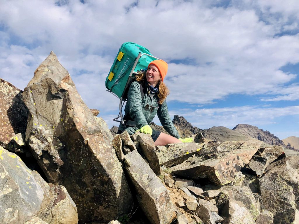 Brittney Woodrum, a graduate student at the University of Denver, climbed all 58 of Colorado's 14,000-foot peaks this summer. She raised about $85,000 for ShelterBox, a global crisis relief organization, carrying the nonprofit's big, green box with her throughout the project.