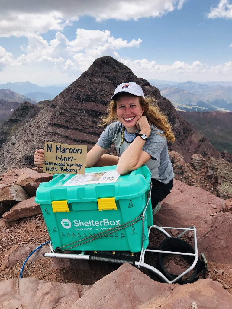 Brittney Woodrum, a graduate student at the University of Denver seen here on North Maroon Peak, climbed all 58 of Colorado's 14,000-foot peaks this summer. She raised about $85,000 for ShelterBox, a global crisis relief organization, carrying the nonprofit's big, green box with her throughout the project.