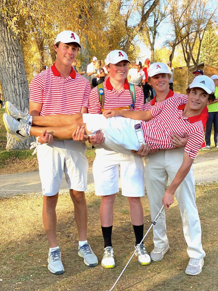 Aspen High School junior Nic Pevny is held up by senior teammates, from left, Cole Kennedy, Jake Doyle and Andrew Vallone on Tuesday, Oct. 6, 2020, after Pevny became the program's first individual state champion by winning the Class 3A state golf tournament at Dos Rios Golf Club in Gunnison.