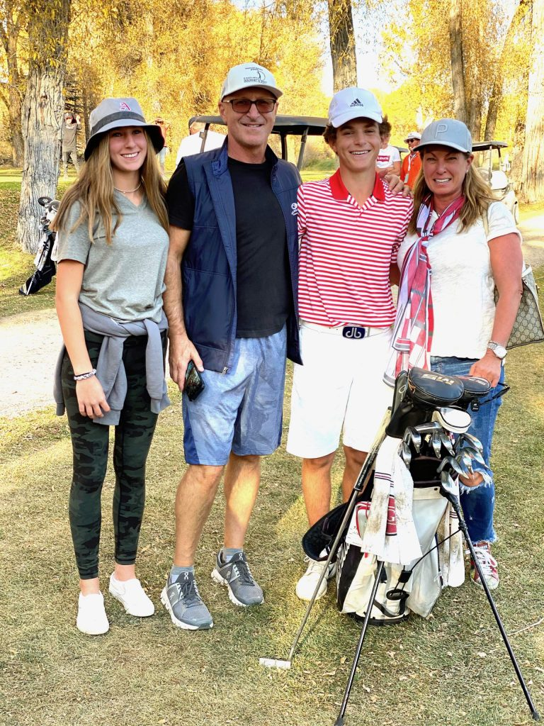 Aspen High School junior Nic Pevny, second from right, stands with his family on Tuesday, Oct. 6, 2020, after he became the program's first individual state champion by winning the Class 3A state golf tournament at Dos Rios Golf Club in Gunnison.
