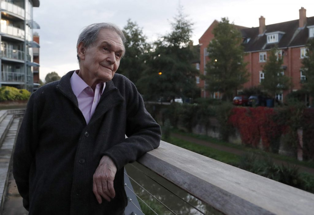 Roger Penrose poses for a photographer in Oxford, England, on Tuesday, Oct. 6, 2020. Penrose, German Reinhard Genzel and American Andrea Ghez won the 2020 Nobel Prize in physics for advancing our understanding of black holes, the all-consuming monsters that lurk in the darkest parts of the universe and still confound astronomers.