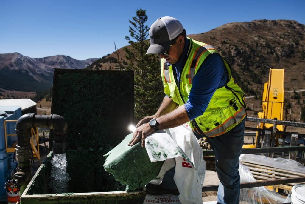 Todd Sutton combines water and a wood mulch mix into a vehicle to spray on the side of Independence Pass on Wednesday, Sept. 30, 2020.