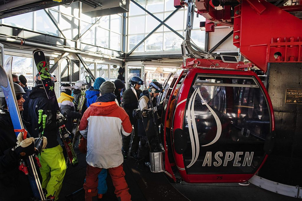 Aspen Ski Company loads skiers into the Silver Queen Gondola during opening day on Aspen Mountain on Saturday, November 23, 2019. Procedures will look different this winter. (Kelsey Brunner/The Aspen Times)