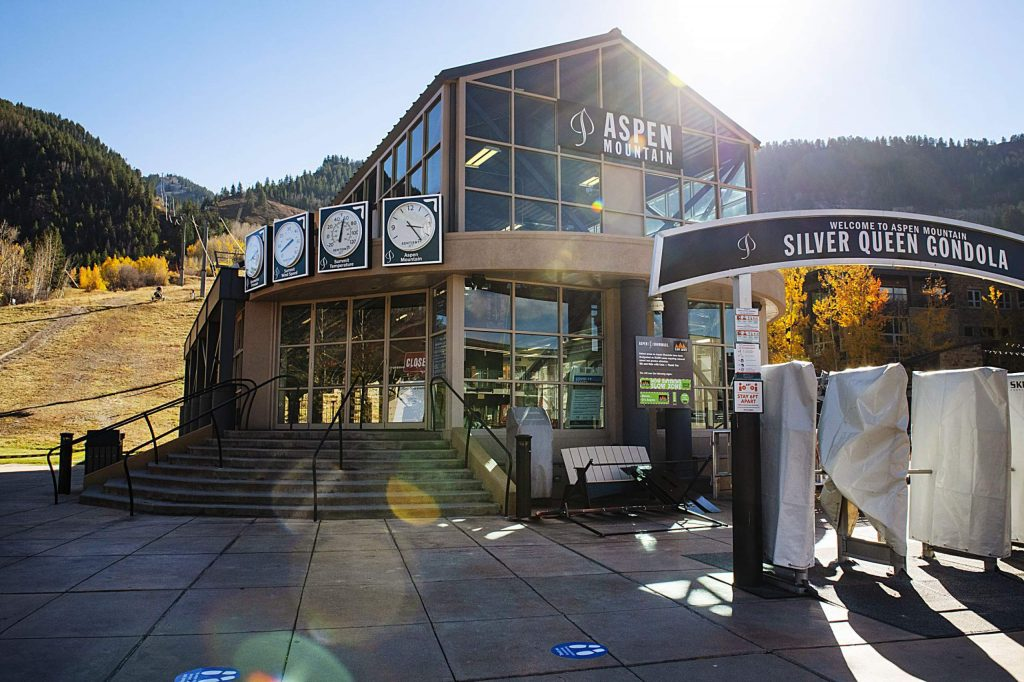Sun streams in on an empty gondola plaza on Wednesday, Oct. 14, 2020. Aspen Skiing Co. will use 'ghost lanes' to socially distance skiers and riders during the winter. (Kelsey Brunner/The Aspen Times)