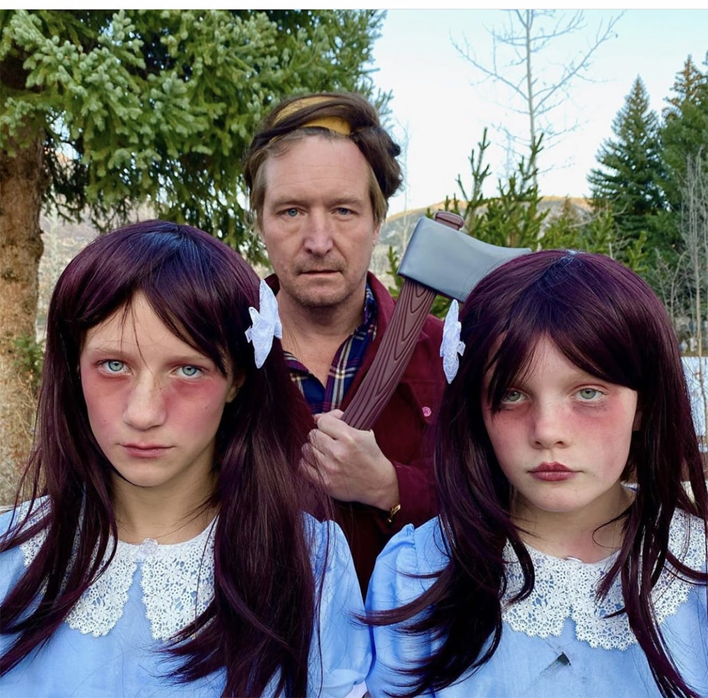 Is there anything scarier than The Shining? David Valentine as Jack Torrance with his daughter Gigi and her friend Eliza Dupps as the Grady twins. Gigi's mom, Ellie, handmade these costumes.
