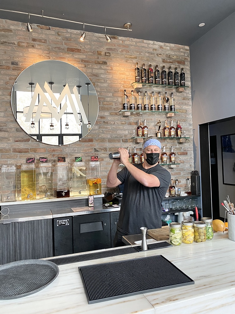 Carey Shanks shakes up drinks in the Marble Bar at Marble Distilling Co.