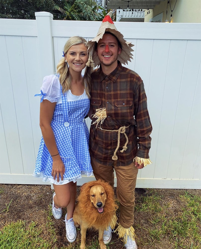 Callie Poll and Alex Swecker with their favorite lion on Halloween 2020.