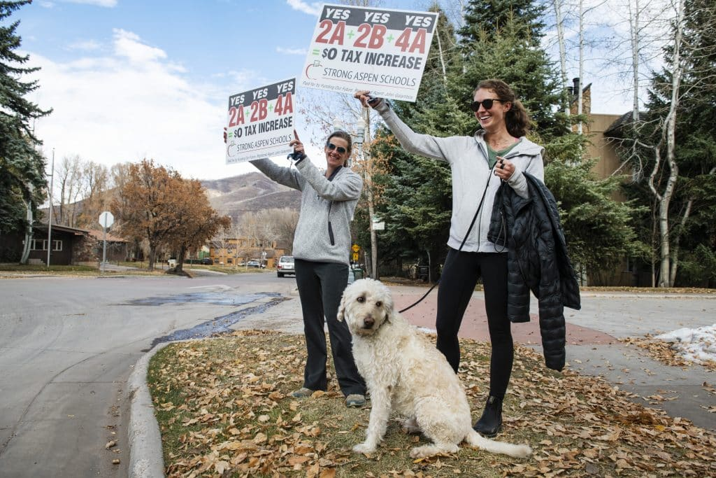 Susan Marolt, left, and her daughter Lucy Marolt stand near the road in Aspen to campaign for the Aspen School District questions on Election Day, Tuesday, Nov. 3, 2020. Susan is on the school board and Lucy attended school through the Aspen Public School system.