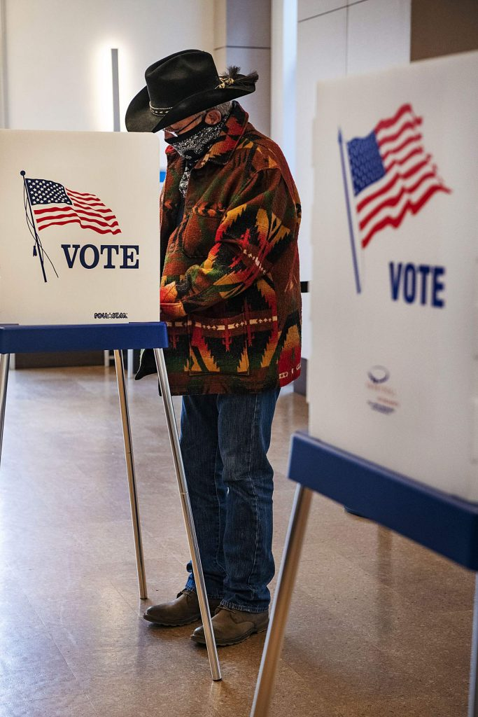"""David """"Mac"""" McWorter fills out is ballot on Election Day in the Aspen Jewish Community Center on Tuesday, Nov. 3, 2020. (Kelsey Brunner/The Aspen Times)"""