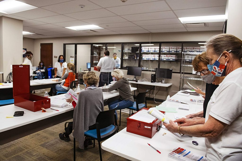 Election officials open and check ballots in the Pitkin County Administration building on Election Day in Aspen on Tuesday, Nov. 3, 2020. (Kelsey Brunner/The Aspen Times)
