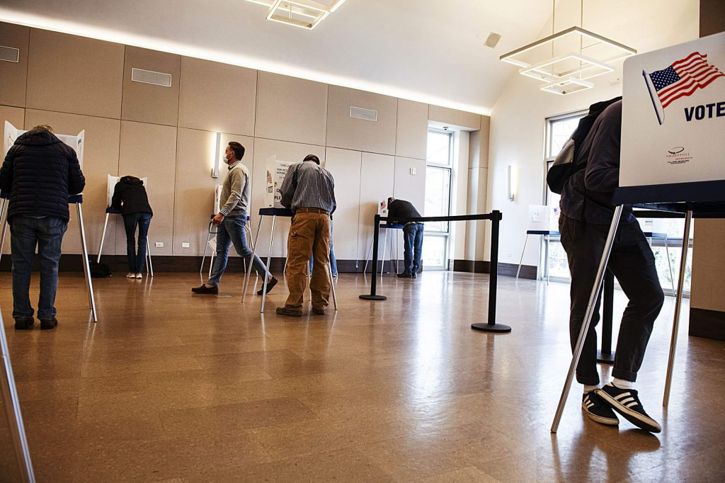 Voters fill out their ballots at socially distanced voting booths in the Aspen Jewish Community Center on Election Day, Tuesday, Nov. 3, 2020. (Kelsey Brunner/The Aspen Times)